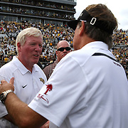 UCF Head Coach George O'Leary congratulates Steve Spurrier ® after an NCAA football game between the South Carolina Gamecocks and the Central Florida Knights at Bright House Networks Stadium on Saturday, September 28, 2013 in Orlando, Florida. South Carolina won the game 28-25. (AP Photo/Alex Menendez)