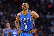 Feb 8, 2016; Phoenix, AZ, USA; Oklahoma City Thunder guard Russell Westbrook (0) smiles on the court in the game against the Phoenix Suns at Talking Stick Resort Arena.  The Oklahoma City Thunder won 122- 106.  Mandatory Credit: Jennifer Stewart-USA TODAY Sports