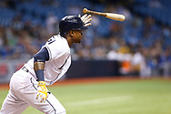 May 9, 2017 - St. Petersburg, Florida, U.S. - WILL VRAGOVIC   |   Times.Tampa Bay Rays shortstop Tim Beckham (1) connects for an RBI single, scoring first baseman Rickie Weeks (8), in the first inning of the game between the Kansas City Royals and the Tampa Bay Rays at Tropicana Field in St. Petersburg, Fla. on Tuesday, May 9, 2017. (Credit Image: © Will Vragovic/Tampa Bay Times via ZUMA Wire)