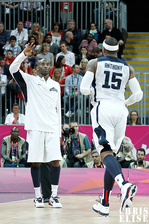 02 August 2012: USA Carmelo Anthony is congratulated by Kobe Bryant during 156-73 Team USA victory over Team Nigeria, during the men's basketball preliminary, at the Basketball Arena, in London, Great Britain.