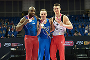 Podium winners (L-R) Donnell Whittenburg of the United States of America (USA), Silver Medal, Oleg Verniaiev of the Ukraine (UKR), Gold Medal, Lukas Dauser of Germany (GER), Bronze Medal during the iPro Sport World Cup of Gymnastics 2017 at the O2 Arena, London, United Kingdom on 8 April 2017. Photo by Martin Cole.