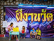 24 NOVEMBER 2015 - BANGKOK, THAILAND:  People wait to get into a haunted house at the Wat Saket temple fair. Wat Saket is on a man-made hill in the historic section of Bangkok. The temple has golden spire that is 260 feet high which was the highest point in Bangkok for more than 100 years. The temple construction began in the 1800s in the reign of King Rama III and was completed in the reign of King Rama IV. The annual temple fair is held on the 12th lunar month, for nine days around the November full moon. During the fair a red cloth (reminiscent of a monk's robe) is placed around the Golden Mount while the temple grounds hosts Thai traditional theatre, food stalls and traditional shows.       PHOTO BY JACK KURTZ