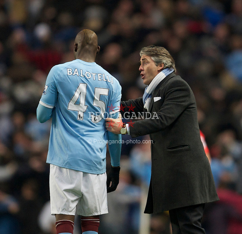 MANCHESTER, ENGLAND - Sunday, March 13, 2011: Manchester City's manager Roberto Mancini and Mario Balotelli during the FA Cup 6th Round match against Reading at the City of Manchester Stadium. (Photo by David Rawcliffe/Propaganda)