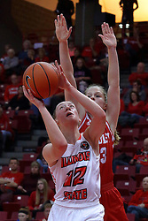 01 January 2017: Millie Stevens looks to get past Anneke Schlueter during an NCAA Missouri Valley Conference Women's Basketball game between Illinois State University Redbirds the Braves of Bradley at Redbird Arena in Normal Illinois.