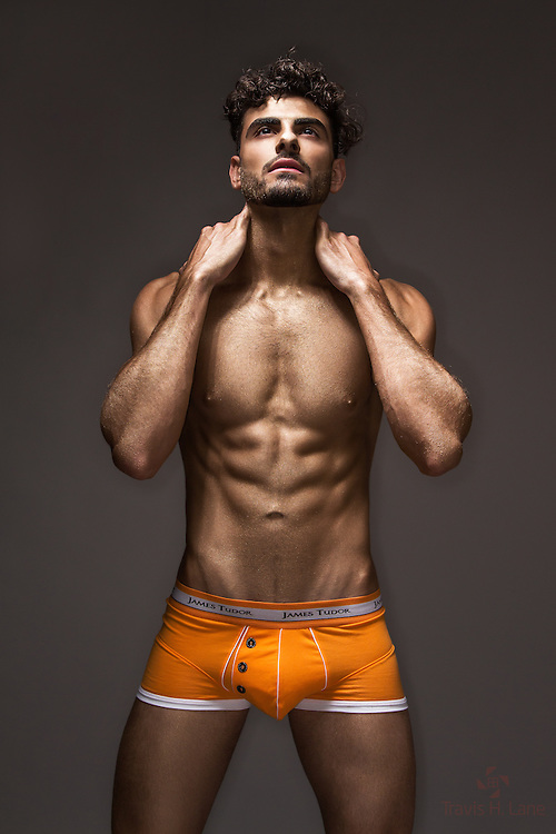 Alex Garibyan as a Golden Boy wearing orange James Tudor underwear
