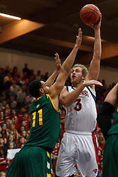 Jan 9, 2012; Moraga CA, USA;  St. Mary's Gaels forward Mitchell Young (3) shoots over San Francisco Dons center Justin Raffington (11) during the first half at McKeon Pavilion.  St. Mary's defeated San Francisco 87-72. Mandatory Credit: Jason O. Watson-US PRESSWIRE