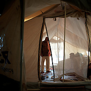 August 12, 2013 - Zaatari, Jordan: Mahmoud Amarin, a 70 year old syrian bus driver from Daraa city, chats with a friend in his tent at Zaatari refugee camp, in northern Jordan. Mr. Amarin fled the fighting in Syria one year ago, when his house got shelled by the regime forces. Like many other refugees in Zaatari, Mr. Amarin lost two of his children during the attack to his village, leaving behind all his worldly possessions. He lives now at the camps with his wife and two children, and depends uniquely on basic aid provided by international Non-Governmental Organisations. Mr. Amarin intends to go back to his hometown soon, due to the harsh life refugees endure at camp. Zaatari camp, home to more than 120,000 people who in the past year have fled the conflict in Syria, become the fourth largest city in Jordan and the world's second largest refugee camp behind Dadaab in eastern Kenya. Most of its residents came from Daraa, a city about 30Km away in Syria, rich with businessmen thanks to a long history of cross-border trade with Jordan. (Paulo Nunes dos Santos/Al Jazeera)