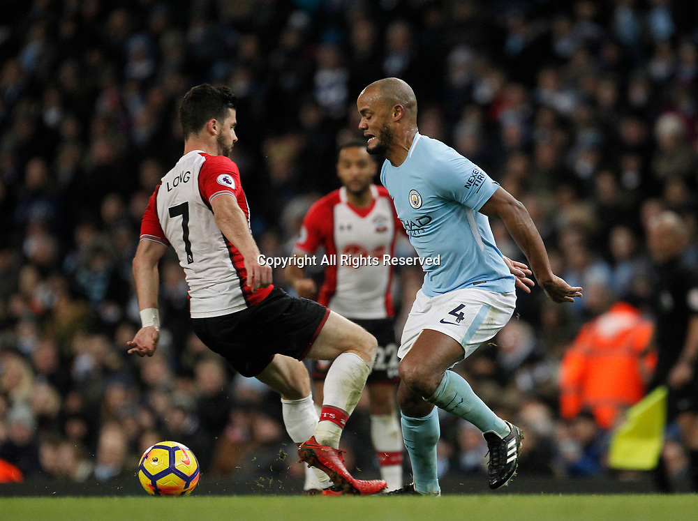 29th November 2017, Etihad Stadium, Manchester, England; EPL Premier League football, Manchester City versus Southampton; Vincent Kompany wins a challenge against Shane Long of Southampton