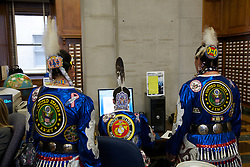 The Native American Women Warriors color guard members confer on a letter to President Obama, asking him to create a coin to commemorate women in the military. L to R: SGT Francis BigMan (Crow), SGT Sarah Kristine Baker (Northern Cheyenne), and SGT Julia Kelly (Crow)