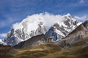 Yerupaja Grande (left 6635 m / 21,770 ft) and Yerupaja Chico (right). Yerupaja Grande is Peru's 2nd highest peak and is also the highest peak in the Amazon River Basin. Day 2 of 9 days trekking around the Cordillera Huayhuash in the Andes Mountains, Peru, South America.