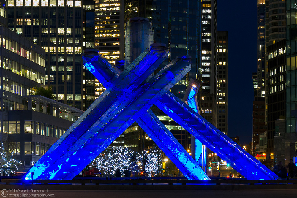 The Olympic Cauldron at Jack Poole Plaza at night.  This was the Olympic Cauldron during the Vancouver 2010 Winter Olympics/Paralympics and is now lit only during special events. Jack Poole was the head of the VANOC bid committee and was part of the team responsible for Vancouver's winning bid.  Jack Poole died in 2009 and Thurlow Plaza was renamed Jack Poole Plaza in his honour.