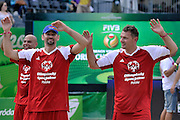 Sebastian Swiderski (L) and Pawel Pake (R) celebrate a winning point while exhibition match of Special Olympics Poland during Day 7 of the FIVB World Championships on July 7, 2013 in Stare Jablonki, Poland. <br /> <br /> Poland, Stare Jablonki, July 07, 2013<br /> <br /> Picture also available in RAW (NEF) or TIFF format on special request.<br /> <br /> For editorial use only. Any commercial or promotional use requires permission.<br /> <br /> Mandatory credit:<br /> Photo by &copy; Adam Nurkiewicz / Mediasport