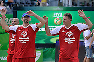 Sebastian Swiderski (L) and Pawel Pake (R) celebrate a winning point while exhibition match of Special Olympics Poland during Day 7 of the FIVB World Championships on July 7, 2013 in Stare Jablonki, Poland. <br /> <br /> Poland, Stare Jablonki, July 07, 2013<br /> <br /> Picture also available in RAW (NEF) or TIFF format on special request.<br /> <br /> For editorial use only. Any commercial or promotional use requires permission.<br /> <br /> Mandatory credit:<br /> Photo by © Adam Nurkiewicz / Mediasport