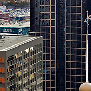 Jim Phelan, a steeplejack from Pacifica, California, worked atop a 40-foot flagpole on the Commerce Bank building at 1000 Walnut Street in downtown Kansas City, Mo. on Wednesday morning, repairing the pulley assembly on the aluminum pole to make the flagpole functional again. Phelan, 58, a third-generation steeplejack with J.C. Phelan Co., has been working in dizzying heights for 40 years. His 10-year-old son, Jells, has shown interest in continuing the family business. Phelan's company is one of two companies in the United States that travel to perform steeplejacking, rigging and flagpole repairs.