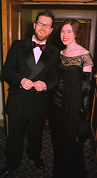 Fashion designer NEIL CUNNINGHAM and his sister MISS SUSIE CUNNINGHAM, at a ball in London on 5th February 1999.MOC 13
