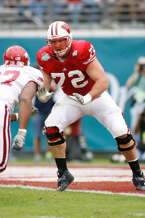 University of Wisconsin offensive lineman Joe Thomas looks to block an opponent during the Wisconsin Badgers 17-14 victory over the Arkansas Razorbacks in the Capital One Bowl at the Florida Citrus Bowl Stadium in Orlando, Florida on January 1, 2007.