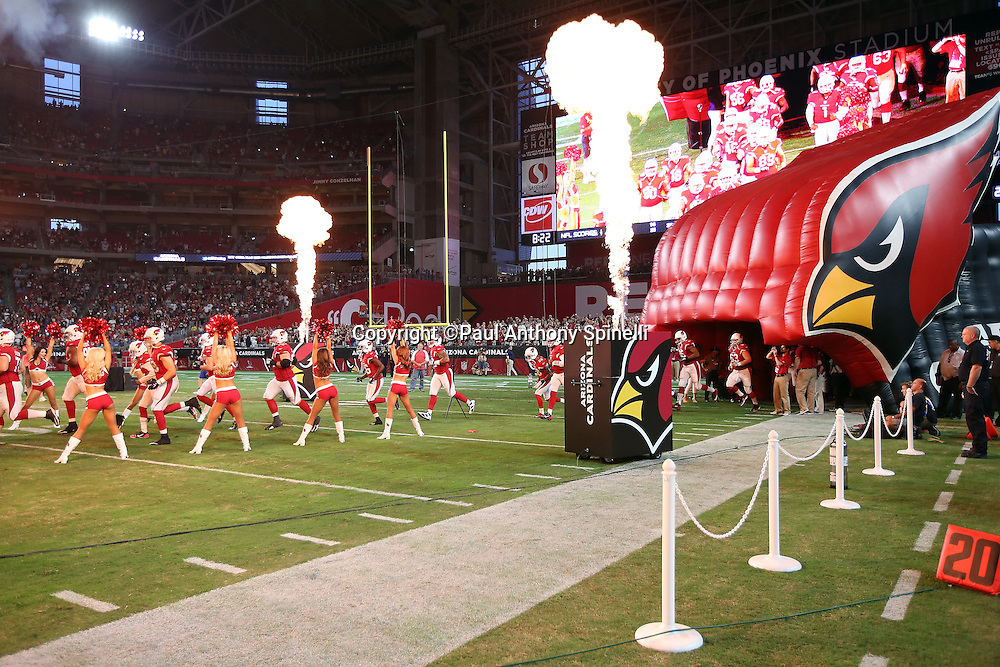 Cheerleaders and fire welcome the team as the Arizona Cardinals are introduced before the 2015 NFL preseason football game against the San Diego Chargers on Saturday, Aug. 22, 2015 in Glendale, Ariz. The Chargers won the game 22-19. (©Paul Anthony Spinelli)