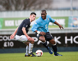 Falkirk's Jonathan Flynn and Dundee's Christian Nade.<br /> Falkirk 2 v 0 Dundee, Scottish Championship game at The Falkirk Stadium.<br /> &copy; Michael Schofield.