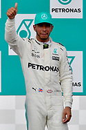 Lewis Hamilton of Mercedes AMG Petronas celebrates coming second in the Malaysian Formula One Grand Prix at the Sepang International Circuit, Malaysia.<br /> Picture by EXPA Pictures/Focus Images Ltd 07814482222<br /> 01/10/2017<br /> *** UK &amp; IRELAND ONLY ***<br /> <br /> EXPA-EIB-171001-0221.jpg