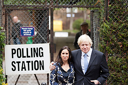 © Licensed to London News Pictures. 03/05/2012. LONDON, UK. London Mayor Boris Johnson and his wife, Marina Wheeler, stand outside a polling station in Islington, North London, after casting their vote in the 2012 mayoral and council elections. Photo credit: Matt Cetti-Roberts/LNP