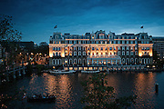 Amstel Hotel after sundown.