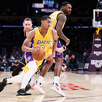 05 December 2016: Los Angeles Lakers guard Jordan Clarkson (6) drives past Utah Jazz forward Gordon Hayward (20) on a screen set by Los Angeles Lakers center Tarik Black (28) during the Utah Jazz 107-101 victory over the Los Angeles Lakers, at the Staples Center, Los Angeles, California, USA.