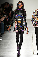 Olivia Anakwe walks the runway wearing Custo Barcelona Fall 2016 20th Anniversary Collection during New York Fashion Week on February 14, 2016