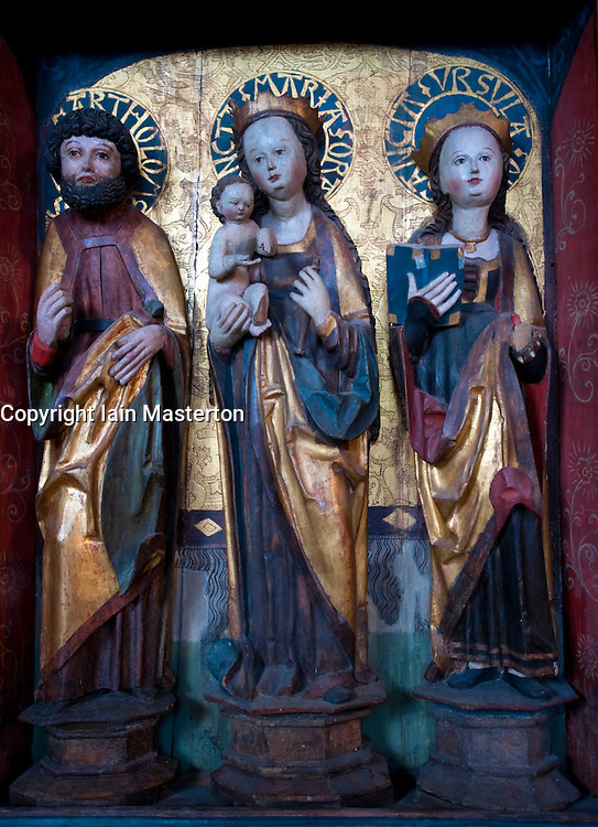 Medieval carved wooden religious figures on display at Markisches Museum in central Berlin Germany