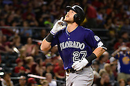 Apr 29, 2016; Phoenix, AZ, USA; Colorado Rockies shortstop Trevor Story (27) gestures while touching home plate after hitting a two run home run against the Arizona Diamondbacks in the fifth inning at Chase Field. Mandatory Credit: Jennifer Stewart-USA TODAY Sports
