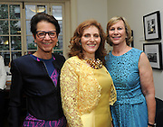 Hunter College President Jennifer J. Raab, center, greets Hunter College Foundation Trustee Jody Arnhold, left, and Laurie Tisch at the Hunter College Summer Garden Party, Tuesday, July, 8, 2014, at Roosevelt House in New York. (Photo by Diane Bondareff/Invision for Hunter College/AP Images)