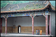 Monks talk in an old structure in Wu Tai Xian, China.