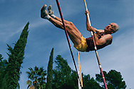 Defying his 85 years, Carol Johnson practices pole vaulting in Walnut California.  He holds (in 1996) the world record of 7 feet 6 inches for his age.