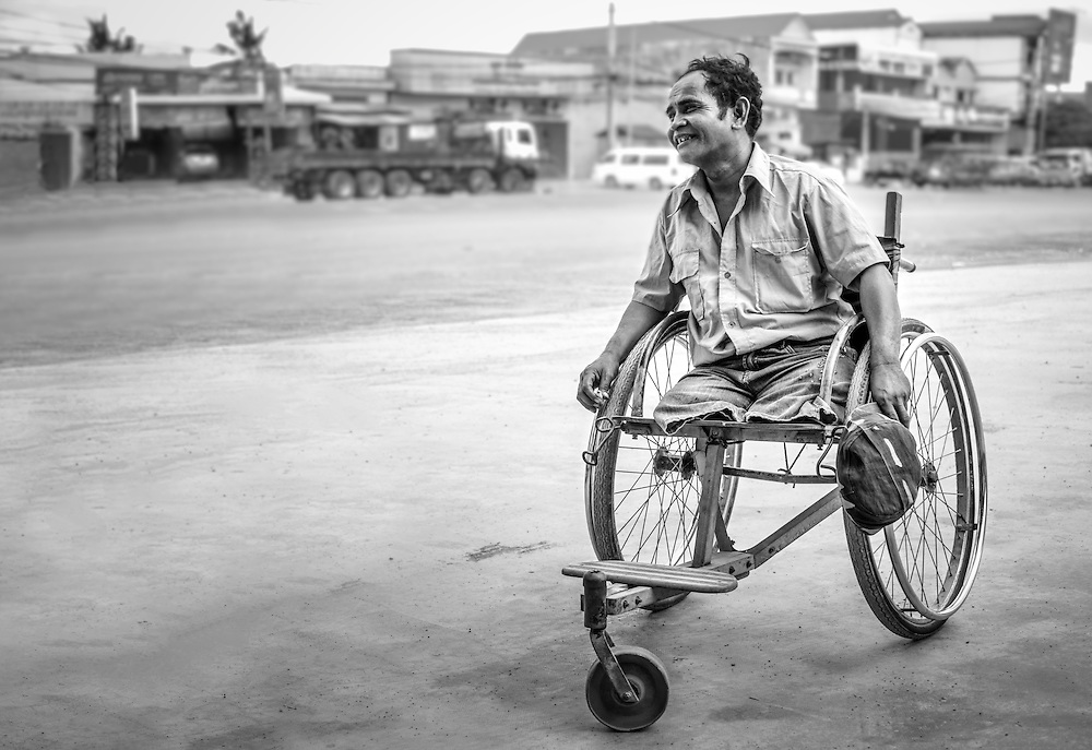 A disabled war veteran in Cambodia. He lost his legs due a land mine.