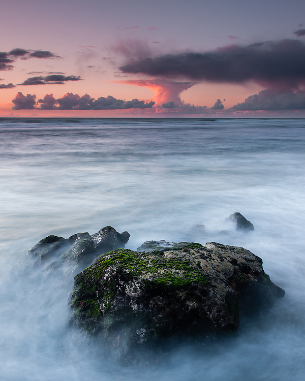At Aguda Beach, near Sintra, after a passing shower, oddly shaped clouds formed on the horizon, just in time for sunset.
