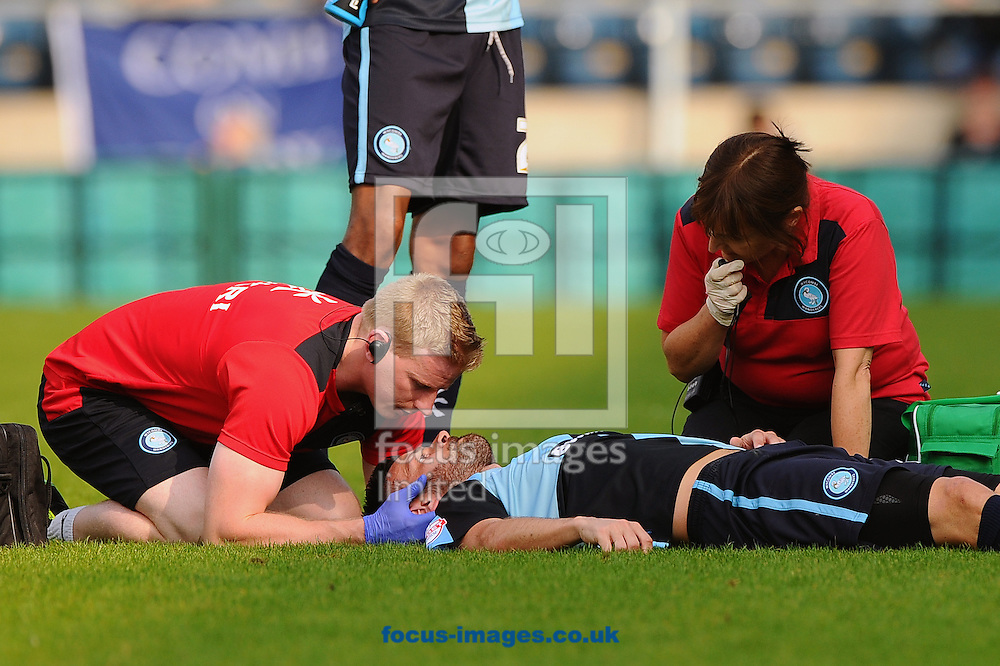 Steven Craig of Wycombe Wanderers receives medical attention after landing awkwardly during the Sky Bet League 2 match at Adams Park, High Wycombe<br /> Picture by Seb Daly/Focus Images Ltd +447738 614630<br /> 06/09/2014