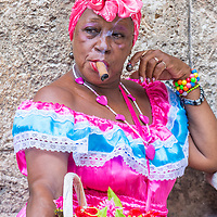 HAVANA, CUBA - JULY 18 : A portrait of a Cuban woman smoking cigar in old Havana street on July 18 2016. Cuba now exports more than 90 million cigars a year