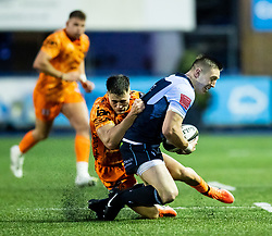 Josh Adams of Cardiff Blues is tackled by Jared Rosser of Dragons<br /> <br /> Photographer Simon King/Replay Images<br /> <br /> Guinness PRO14 Round 9 - Cardiff Blues v Dragons - Thursday 26th December 2019 - Cardiff Arms Park - Cardiff<br /> <br /> World Copyright © Replay Images . All rights reserved. info@replayimages.co.uk - http://replayimages.co.uk