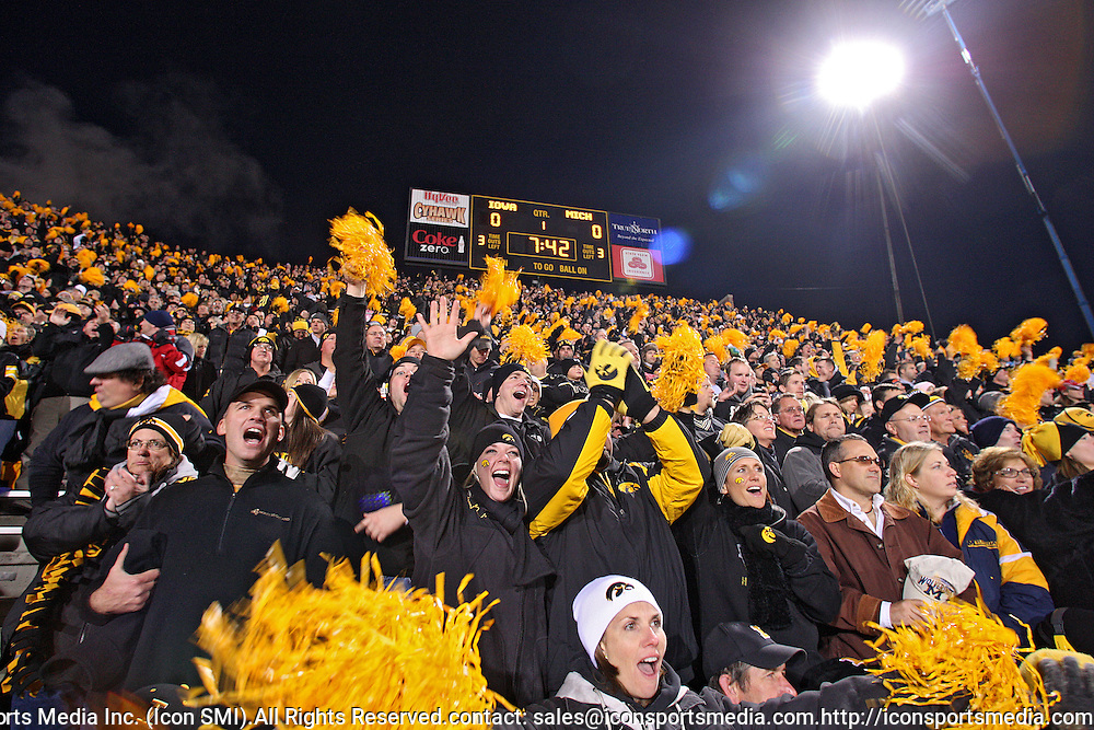 October 10, 2009: Iowa fans cheer before the Iowa Hawkeyes' 30-28 win over the Michigan Wolverine's at Kinnick Stadium in Iowa City, Iowa on October 10, 2009.