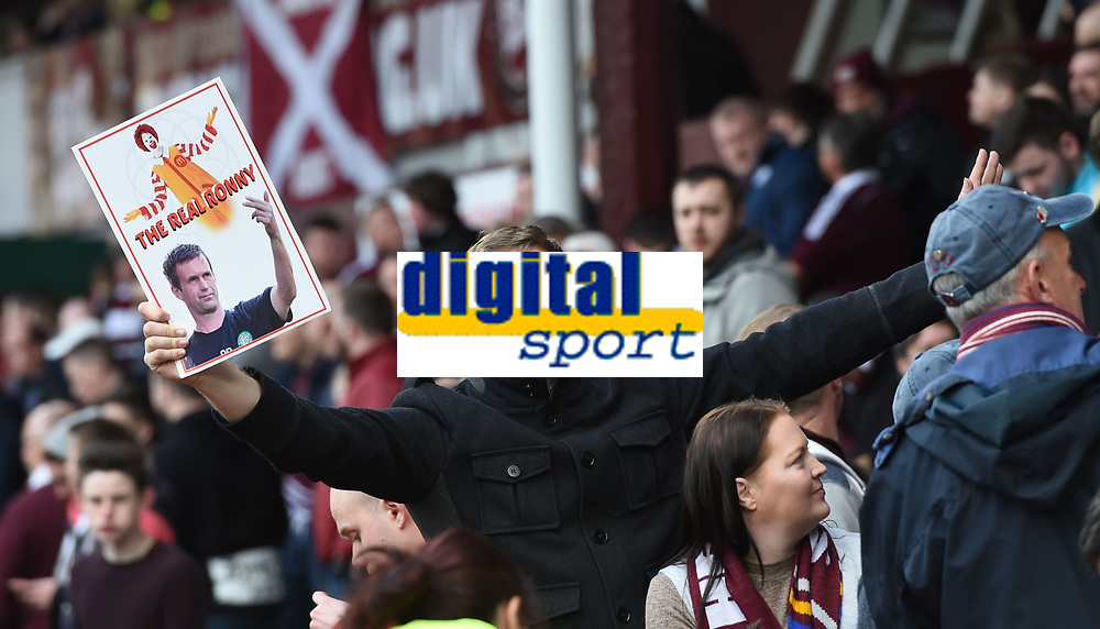 30/04/16 LADBROKES PREMIERSHIP<br /> HEARTS v CELTIC<br /> TYNECASTLE - EDINBURGH<br /> A Hearts fan raises a card poking fun at departing Celtic manager Ronny Deila