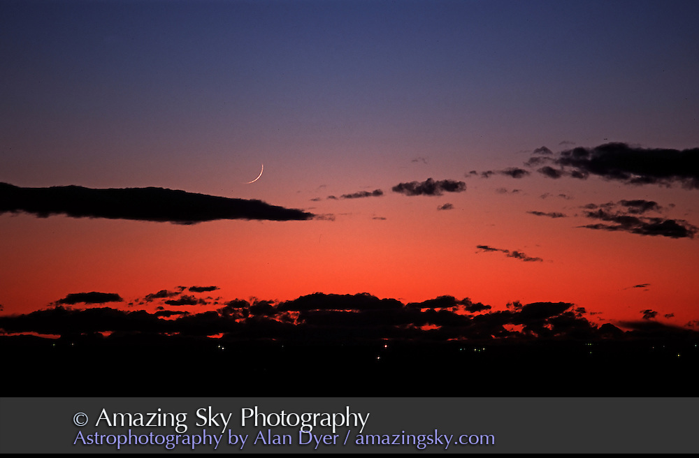 Thin waxing Moon April 13 -- part of big line up of planets in spring 2002.