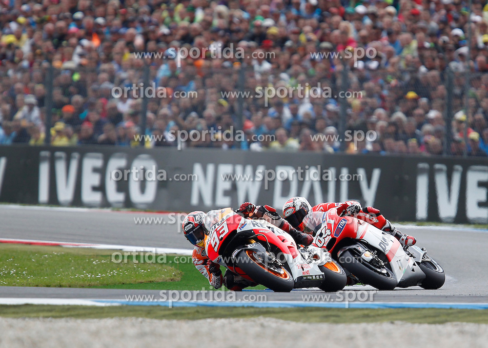 28.06.2014, TT Circuit, Assen, NED, MotoGP, Assen, im Bild 93 Marc Marquez vor 4 Andrea Dovizioso // during the MotoGP Iveco TT Assen at the TT Circuit in Assen, Netherlands on 2014/06/28. EXPA Pictures &copy; 2014, PhotoCredit: EXPA/ Eibner-Pressefoto/ FOTO-SPO_AG<br /> <br /> *****ATTENTION - OUT of GER*****