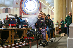 © Licensed to London News Pictures. 17/01/2020. London, UK. Members of public travel on a miniature steam train at the annual London Model Engineering Exhibition at Alexandra Palace in north London. Clubs and societies are exhibiting spectrum of modelling from traditional model engineering, steam locomotives and traction engines through to the more modern gadgets including trucks, boats, aeroplanes and helicopters with nearly 2,000 models constructed by their members. Photo credit: Dinendra Haria/LNP