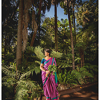 Sushi Das is a jounralist of Indian heritage. Pictured in the Botanical gardens in Melbourne with Funugreek, a herb she has been looking for in Melbourne for 23 years. Picture by Shannon Morris. 17.9.16