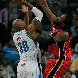 30 January 2009: New Orleans Hornets forward David West (30) shoots over Golden State Warriors forward Ronny Turiaf (21) during a 91-87 loss by the New Orleans Hornets to Golden State Warriors at the New Orleans Arena in New Orleans, LA.