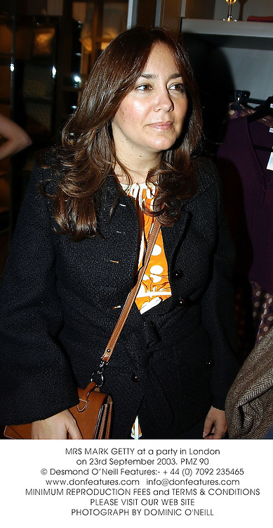 MRS MARK GETTY at a party in London on 23rd September 2003.PMZ 90