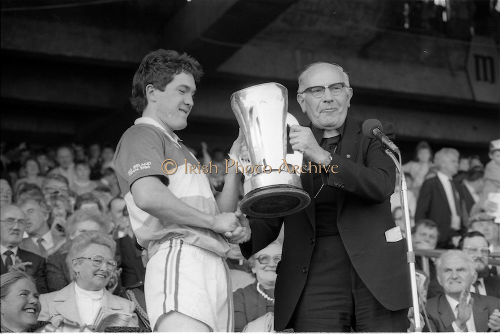 07/09/1986<br /> 09/07/1986<br /> 7 September 1986<br /> All-Ireland Senior and Minor Hurling Finals at Croke Park, Dublin.<br /> Dr. T. Morris, Archbishop of Cashell (right) patron of the G.A.A. presenting the Minor Hurling Cup to Michael Hogan, captain of the Offaly team.