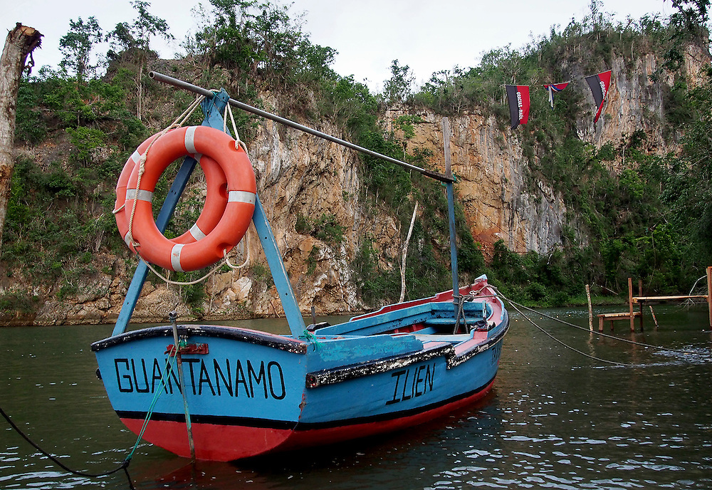 "Boat on the Yumuri river, just outside the city of Baracoa in Cuba. It is in the District of Guantanamo made infamous for the jail being run by the USA holding ""enemy combatants"""