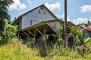 """Abandoned Strawn Citrus Packing House District<br /><br />In the late-1800s, the expansion of the railway system into southern Florida opened up the area to new industry and expanded potential business opportunities. Florida was promoted as a paradise on earth, where the """"climate cured all aliments and the soil produced wealth with little effort"""". The emerging citrus industry helped in the selling of land as settlers caught """"orange fever"""", assuming they could make good money selling to the northern states.<br /><br />At the time, Florida was producing over 5 million boxes of citrus, but it all ended when the state was hit with devastating back-to-back freezes. In 1894 and 1895, temperatures throughout the state dropped, leaving many growers to watch as their crops died out. The first freeze occurred on December 20, 1894. Unfortunately, the state experienced a month of warm weather leaving the citrus groves more vulnerable for the second freeze on February 8, 1895. This event paralyzed the citrus industry and it wouldn't recover from it for a couple more decades.<br /><br />As the citrus industry moved south following the freezes, the few groves which survived gained widespread notoriety. One of these highly reputable groves was Thomas Strawn's """"Bob White"""" oranges.<br /><br />Back in 1882, Theodore Strawn settled down in West Volusia County and began an orange packing operation. Ever though the freezes of 1894-1895 eradicated most of the livelihoods of the farmers nearby, the business continued to prosper. In 1921, the original wooden packing house burned down and it was replaced by a new state-of-the-art steel building with a distinctive saw tooth roof line.<br /><br />The next few decades were kind to the Strawn family as the business grew. Of the oranges they grew, only the best were given the """"Bob White"""" mark, named after the Northern Bobwhite quails the Strawn family enjoyed hunting. While the """"Bob White"""" oranges were shipped up north, the lower-classed oranges """
