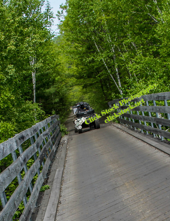 Crew of ATV's & UTV's starting to cross a bridge in New England, NH, New Hampshire, New England, bridge, atv, utv, sxs, ohrv, orv, trail riding, hobby, adventure, sports, therapy, Click Stock Photography