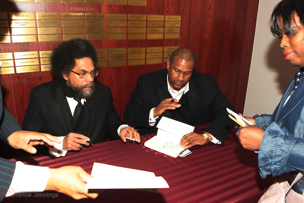 "April 18, 2012- New York, NY : (L-R) Dr. Cornel West and Tavis Smiley sign copies of new book at the Tavis Smiley and Cornel West Talk and Booksigning of their co-authored new book ' The Rich & the Rest of Us: A Poverty Manifesto ' presented by Dr. Brenda Greene and the National Black Writers Conference held at the Slyvia and Danny Kaye Playhouse at Hunter College (CUNY) on April 20, 2012 in New York City. ..The latest census data shows nearly one in two Americans, or 150 million people, have fallen into poverty  or could be classified as low income. Dr. Cornel West and Tavis Smiley, who continue their efforts to spark a national dialog on the poverty crisis with the new book, ""The Rich and the Rest of Us: A Poverty Manifesto."" (Photo by Terrence Jennings)."